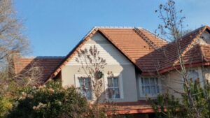 Roof repairs on a high pitch tile roof