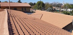 Waterproofing and painted low pitch tile roof