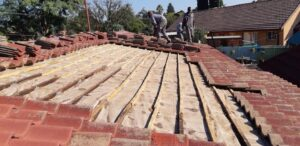 Batons repaired on a low pitch tile roof