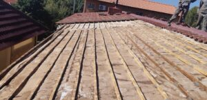 Batons replaced on a low pitch tile roof